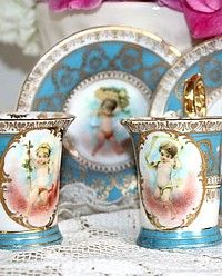 Complimentary Pair of Cabinet Gilt Cherub Demitasse Cups-demi, tasse, gilt, angels, collector,gold, shabby, vienese,dresden,aqua, French, blue,roses