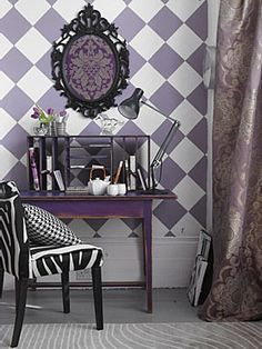 purple wall paper and drapes