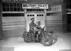 """An MP on motorcycle stands ready to answer all calls around his area. Columbus, Georgia."" April 13, 1942. Pfc. Victor Tampone. (image from www.archives.gov)"
