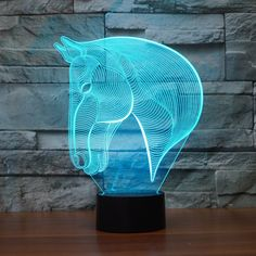 Animal Stallion Horse Lamp Color Changing 3-D LED Animal Stallion Horse Lamp 3D Table Lamp! Grab your 3D illusion LED Night Lamp while you still can! - Illuminates in 7 colors: (press the button to ch