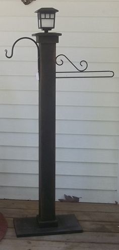 Solar light garden flag/plant post by bethkimble on Etsy, $65.00....this can easily be made on your own for a fracture of the cost