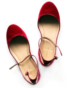 Ruby red flats with ankle straps. Would love these in black as well