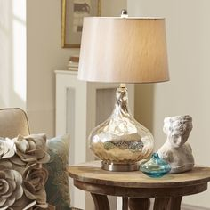 Agatha Table Lamp | The crackled, mercury glass finish on the base of the Agatha Table Lamp elevates the look of its classic silhouette.