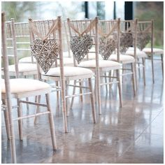 Aisle chairs with willow hearts tied with hessian ribbon. Source: the Wedding of my Dreams. Captured by Katrina Photography. #chairdecor #willowhearts