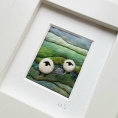 An original piece of textile art by Shropshire-based artist Maxine Smith. A one of a kind needle felted and hand embroidered miniature picture inspired by the natural environment. This little felted landscape has been created by hand using wet felting and free motion embroidery to create a typical British rolling hillside. Wool and fibres have been added with needle felting. The sheep have been needle felted and embroidered and some purple stitches complete the piece. The little felted…