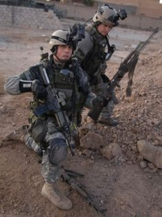 shuttster:  Army Rangers conduct a search of a weapons cache during combat operations in Iraq.