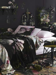 A beautiful moody floral, our classic Floralism design is printed on sumptuous cotton velvet with overblown peonies, flowing tulips and irises, interspersed with small flowers and grasses. Available in sumptuous feather-filled cushions, heavy draping fabric, footstools and other stylish accessories.