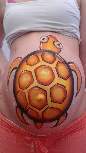 Quick turtle belly paint at the markets by Kate Matthews #facepaint #bellypaint