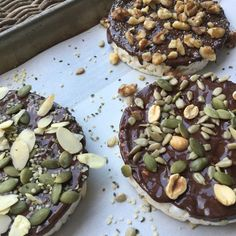 Dark chocolate, nuts and seed rice cakes. A fun low FODMAP treat!