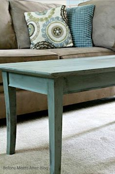 Distress a solid table by painting the bottom coat a different color, allowing it to peak through after sanding.