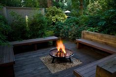 There is definitely room for a fire pit on the master bedroom side of the yard. We'd love it to be inviting like this, with lots of greenery and natural wood, rather than full of concrete like we see many other people use.