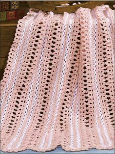 "Snuggly broomstick-lace afghan is made with fine (sport) weight yarn and sizes F, G and Q hooks. Size: 36 1/2"" x 40"".Skill Level: Intermediate"