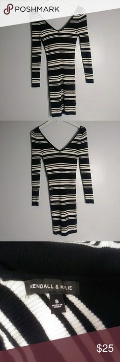 """Kendall & kylie sz:s black&off-white bodycon dress Sz:s Length: 33"""" Chest: 13"""" Sleeve length: 23"""" Kendall & kylie black and off-white stripped bodycon dress. Has v neck and v back Very trendy dress. Kendall & Kylie Dresses Mini"""