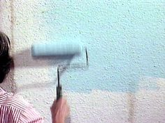 put textured, paintable wallpaper over wood panelling to make it look  like it was never there.