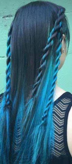 Rope braid. Black hair with teal highlights.