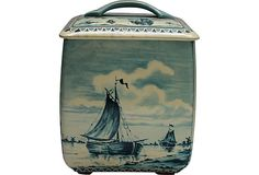 Vintage tin box with lid with images of ships and a windmill, made in Germany.