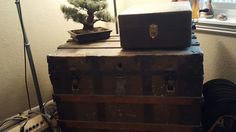 The trunk was my wedding gift from Hayes and the crank record player my wedding gift to hayes. The bonsai was from Hayes our first Christmas together dating. The records on the left passed down from his great grandmother. The amp on the left a gift for my birthday.