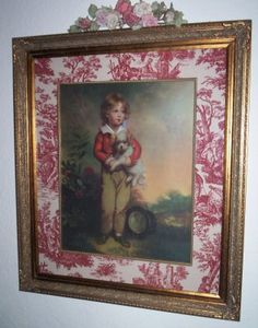 Picture with red toile surround..............ideas for pictures in my bedroom of family.