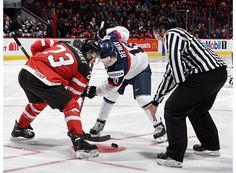 MONTREAL, CANADA - DECEMBER 26: Canada's Sam Reinhart #23 faces off against Slovakia's Martin Reway #10 during preliminary round action at the 2015 IIHF World Junior Championship. (Photo by Richard Wolowicz/HHOF-IIHF Images)
