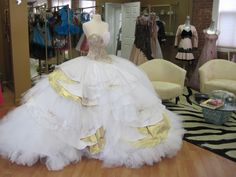 Nettie's multi-layered white with gold accents wedding gown by Sondra Celli