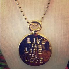 """Live the Life You Love A beautiful 14k gold plated charm necklace by Love Tatum.  The other side says, """"Love the Life you live. Item #14647 Love Tatum Jewelry Necklaces"""