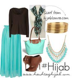 Blue skirt, black shirt, black and blue printed scarf, blue necklace, gold bracelets, brown shoes