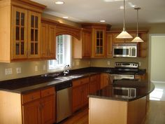 Kitchen, : Wonderful L Shape Kitchen Decoration With Light Brown Wood Kitchen Cabinet, Black Granite Counter Top And Cone Lamp Shade