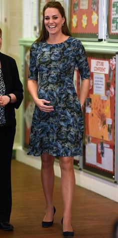 Once inside Cape Hill Children's Centre, the Duchess removed her coat to reveal a floral print maternity dress by Seraphine that highlighted her growing bump.