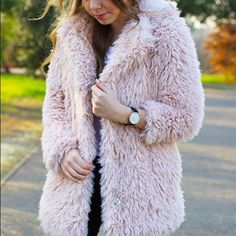 Pink faux fur coat Forever 21 shaggy jacket Small Super warm and cozy faux fur coat from Forever 21. Gorgeous blush pink color. Made of 100% polyester. 30 inches full length, 41 inch chest, 24 inch sleeve length. In size small. Great condition. Has hidden snap button closure in front Forever 21 Jackets & Coats