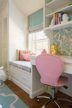 Built-in wardrobe/closet, windowseat with storage and desk / workspace.