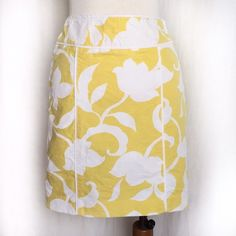 """Ann Taylor Yellow and White Floral Skirt Sunny and bright floral patterned straight skirt. This skirt features a textured pattern on top of the flat floral pattern. Fully lined with an invisible side zipper. White trim. Machine wash. Both shell and lining are 100% cotton. Size 0. Waist: 13"""" flat across. Hip: 18"""" across. Length: 18"""". There is teeny tiny mark on front right hip as shown in last picture (top right). It is unnoticeable when wearing and does not detract from the beauty of this…"""