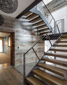 The black walnut staircase has LED lights mounted beneath each riser to illuminate the way at night.