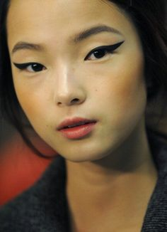 Strong wings on an otherwise neutral look for a simple yet strong look