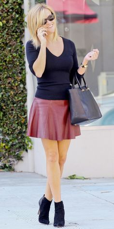 Reese Witherspoon - burgundy leather skirt & black pulover