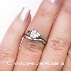 Bridal set with a trillion cut Moissanite set sideways in minimalistic engagement ring and a matching contoured wedding band. Popular Engagement Rings, Designer Engagement Rings, Rose Gold Morganite Ring, Ring Set, Wedding Ring Bands, Ring Designs, Moissanite Rings, Forever Brilliant Moissanite, Forever One Moissanite