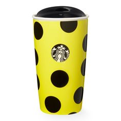 A double-walled ceramic mug featuring a dot pattern and yellow body, part of the Starbucks Dot Collection.