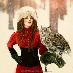 WOMAN WITH EAGLE OWL , one person, woman, women, female, girl, girls, brunette, brown hair, 20-30 years, standing, looking at camera, outdoors, outside, fur hat, corset, bodice, dress, gloves, attractive, beautiful, owl, Eurasian Eagle Owl, owls, falconry, bird, birds, bird of prey, predator, hunting, hunter, snow, snowy, snowing, woods, forest, winter, wintry,