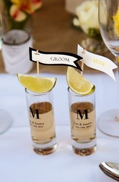 Toast w/ tequila (or drink of choice) in customized shot glasses garnished w/ a lime and little sign. Yes please!