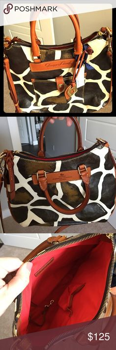 Dooney & Bourke leather giraffe print cross body Dooney & Bourke giraffe print florentine leather cross body. Excellent condition, never used. Dust bag included. Dooney & Bourke Bags Crossbody Bags