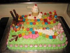 Candyland Cake: Chocolate Cake w/ buttercream icing. Starburst trail, Marshmallows, Raspberry Cream Cheese Mint Hearts, Peppermint discs, Gumdrops, Cherry Balls, Dum Dums, Milk duds, Choc Stix, Ice Cream cone Castle, and lots of sprinkles.