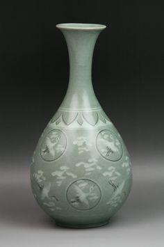 Big Korean Celadon Glaze Porcelain Yuhuchun Vase. Circa 1900.
