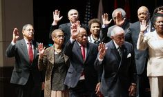 Members of the Congressional Black Caucus Chairman participate in a ceremonial swearing-in, Tuesday, Jan. 6, 2015. on Capitol Hill in Washington, as the 114th Congress began . (AP Photo/Lauren Victoria Burke)