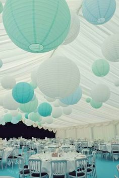 We hung beautiful oversized Paper Lanterns in shades of Sea Greens & Blues in this gorgeous Marquee for an Ibiza Beach Party themed event www.weddingandevents.co.uk