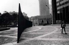 """Richard Serra  Tilted Arc  """"construction leads you into their structure and does not refer to the artist's persona""""  forced uncomfortably on the viewer--loom, dictate paths of movement  reconceived the anti-illusionism of minimal art as an aesthetic of direct physical experience  concentrates on palpable qualities of the materials & on improvisational process of making sculpture  significance in its effort not in its intention--state of mind"""