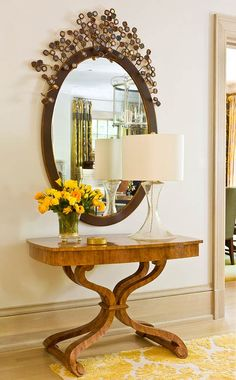 A custom mirror crowns a petite Rose Tarlow table. - Traditional Home ® / Photo: Gordon Beall / Design: David Herchik