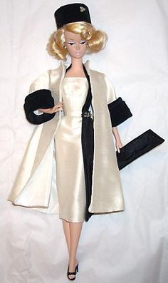 """Bogue's Vogues. Coat and Dress in ivory silk, taffeta and velveteen with """"diamond"""" accent. Matching hat and envelope."""