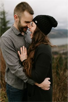 What to wear for engagement photos: dark neutrals - black and grey, plus a black beanie and dark jeans.    Big laughs are the best laughs! Taken at the Portland Women's Forum in the Columbia River Gorge by pacific northwest adventure photographer, Katy Weaver Engagement Photo Outfits, Engagement Photos, Black Beanie, Columbia River Gorge, Dark Jeans, Couple Pictures, Pacific Northwest, North West, What To Wear