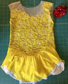 Figure Skating Dress for a Beauty and the Beast program- complete with Red Rose hairpiece by KelleyMatthewsDesigns.com Get your 2017 figure skating dress at www.KelleyMatthewsDesigns.com