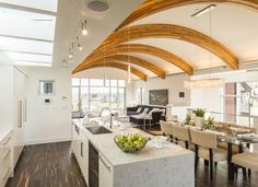 Unique Contemporary Custom Home Architectural Design with Arced Ceiling Wood Beams