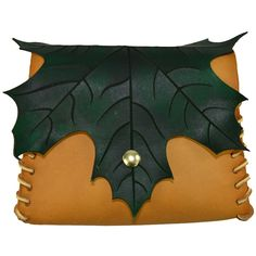 Elven Leaf Leather Pouch. $45.00, via Medieval Collectibles on Etsy.